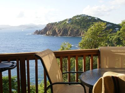 Enjoy alfresco dining on the upper deck overlooking Devers Bay and the Caribbean