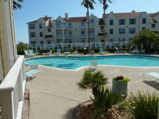 North Padre Island condo photo - Gated pool with hot tub and grills for a cookout