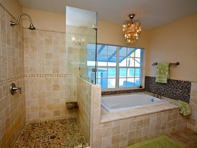 Brand New Master Bathroom with shower enclosure and tub overlooking the ocean