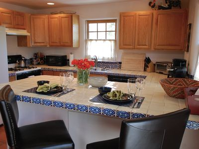 Pretty and Fully Equipped Kitchen with Talavera Tile Accents
