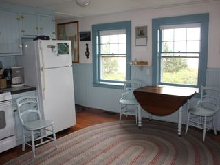 Chatham house photo - A country kitchen greets you when you enter and looks out on Pleasant Bay.