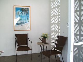 Fort Myers Beach house photo - Screened in front lanai. Great place for your morning coffee.