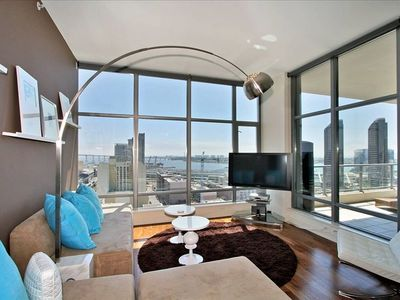 "Modern Furnished Living Room- Floor to Ceiling Windows, 50"" Plasma"