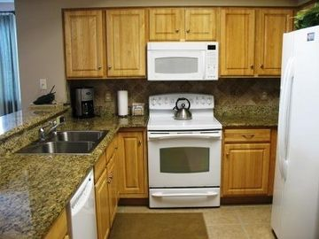 Granite counters and a large pantry, completely outfitted for your convenience