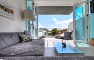 San Juan apartment photo - Living with terrace with the ocean view, the sofa makes two more twin beds