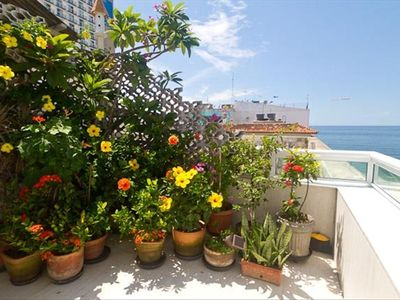 Copacabana condo rental - small patio off office with ocean view. The plants are always blooming.