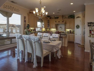 Well appointed gourmet kitchen with relaxing views from the dining room.