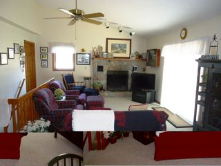 Bellaire / Shanty Creek cottage photo - upper living area with fireplace and TV and slider to deck