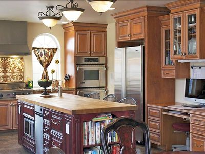 Gourmet kitchen with granite, double ovens, Viking range & TWO dishwashers.
