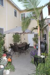 Seal Beach apartment photo - Patio, gas BBQ grill, seating, outdoor shower.