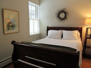Woodstock house photo - Master bedroom with ensuite bath on main floor. Queen sized bed. AC