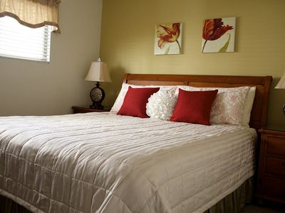 Master Suite furnished with Cal King Bed and plush bedding.