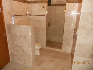 Puerto Penasco condo photo - Master Bath with travertine surrounds, and glass shower door.