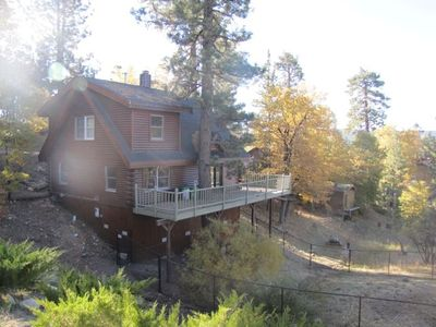 Custom, newer log cabin with luxury comfort. Back yard FULLY FENCED for pets.