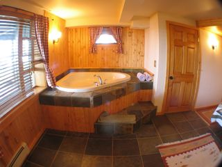 Burt Lake cabin photo - Whirlpool tub in Master Bedroom.