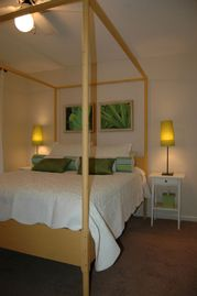 Beaufort townhome rental - Queen bedroom with custom bedding and local art