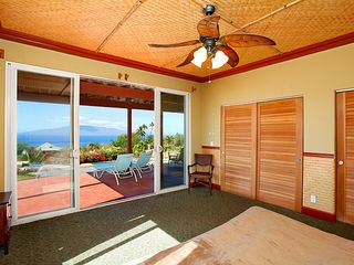 Lahaina house photo - Master bedroom with full size sliders onto lanai and pool deck. Great views!
