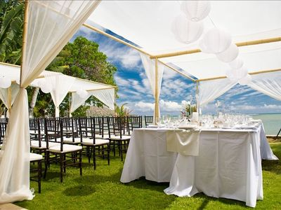Outdoor ceremony and reception with cabana
