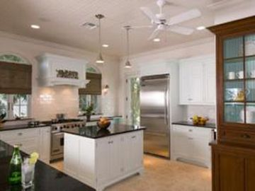 Bright, spacious, fully-equipped kitchen with modern appliances