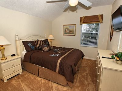 Queen size bedroom with a 32 inch flat screen TV