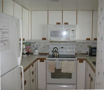 Fully equipped kitchen has lots of dining and cooking equipment