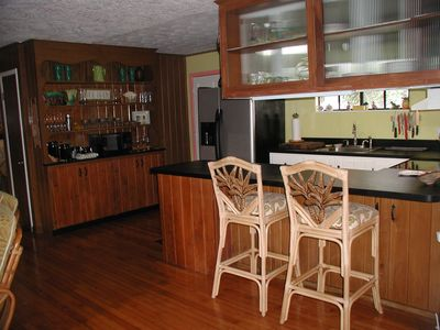 Kitchen is open to the living area and includes a counter for casual meals