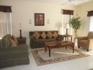Esprit Estates villa photo - Spacious Livingroom Area with Sliding Glass Doors to Patio Area