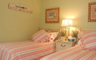 The guest room has two twin beds, large closet, dresser and its own full bath.