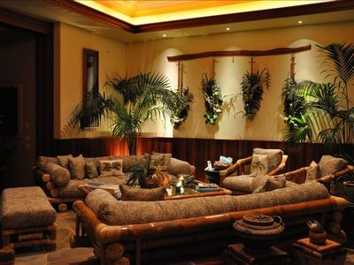The dramatic living room, complete with hanging heliconias and orchids