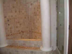 Master Bath tub with separate shower on R side with glass doors