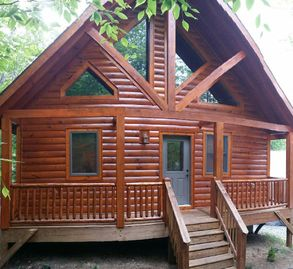 Beech Mountain cabin rental - Front of Cabin with covered Porch and Log Chairs now Available