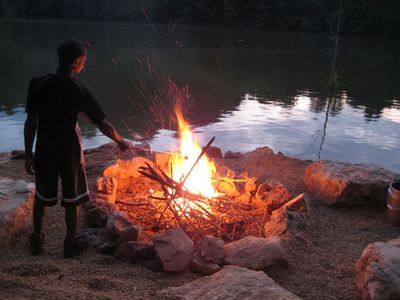 Watauga Lake cabin rental - Enjoy a fire by the lake (wood and marshmallow forks provided).