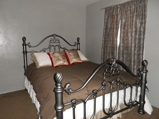 Lubbock house photo - Grey bedroom with queen bed...