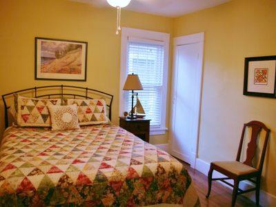 Main Floor Bedroom with Queen bed and walk in closet is ideal for Grandparents