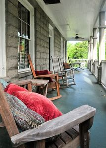 Two spacious porches, with hammock and rocking chairs
