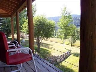 Sit on the wrap around porch and enjoy the bountiful scenery!
