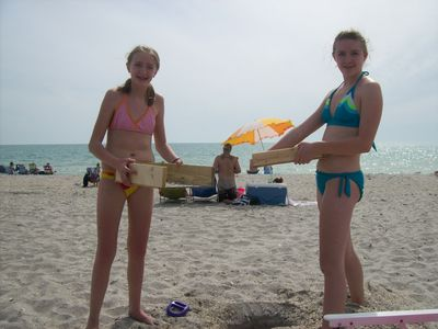 Hailey (15) and Tori (12) off to go looking for sharks teeth on Castaways beach.