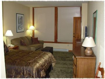 The bedroom suite contains a queen bed and sofa sleeper.