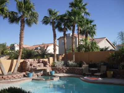 Huge pool, hot tub & waterfall surrounded by 12 thirty feet high palm trees!
