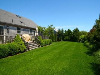 Surfside Nantucket property rental photo - Spend time in the beautiful back yard or grill on the huge porch.