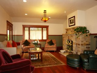 Pacific Grove house photo - Spacious living room with Carmel Stone fireplace and over-sized comfy chairs.