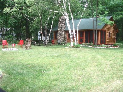 Full view yard with firepit and panoramic lake views; visit soon!