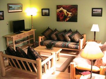Living room with mountain decor. Cable, flat screen TV, free and secure WiFi.