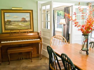 Wimberley property rental photo - Dinning are complete with piano