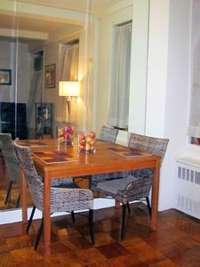 Dinning Area: Dinning table with two chairs & accent light with full wall mirror