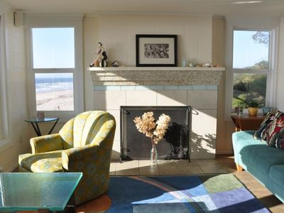 Light filled living room over the beach and ocean, custom upholstery and carpet