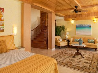 Cruz Bay villa photo - Presidential Suite featuring mahogany staircase, marble flooring, cyprus ceiling