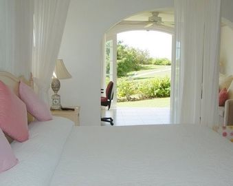 Master bedroom with walkout to gardens and pool