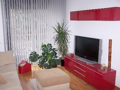 living room with a 3 meter sofa and 37-inch TV with international programming