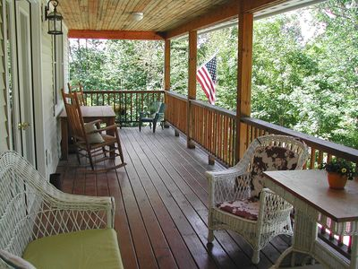 Belmont chateau / country house rental - Covered balcony with table, rockers, and wicker chairs.
